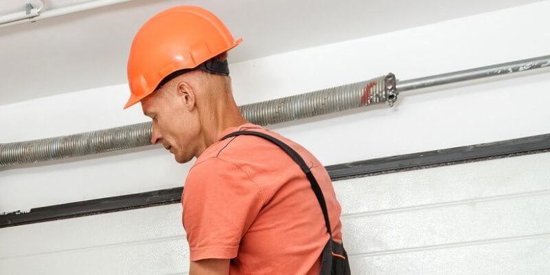 garage door torsion spring replacement - Supreme Garage Door Repair